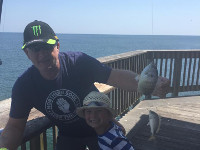 Fishing off pier at Gulf State Park Pier, Alabama